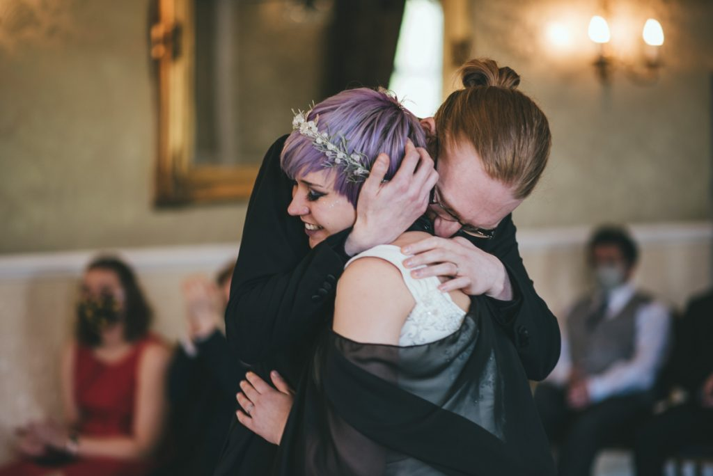 Wedding photographer captures a tender embrace between the bride and groom