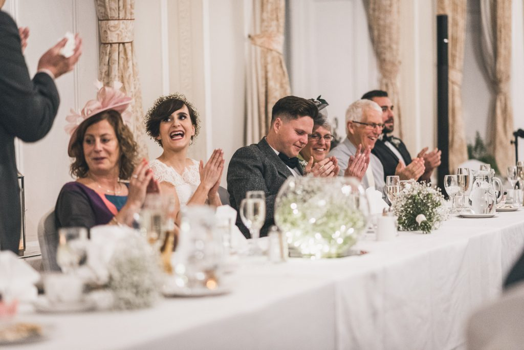 Bride and Groom react to wedding speeches.